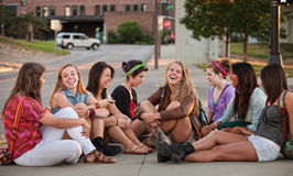 Eight Pretty Girls Sitting Outdoors Stock Images