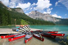 Eight red canoes Stock Images