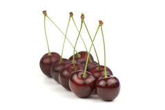 Eight red cherries Stock Photos
