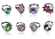 Eight rings. Eight  rings decorated with precious stones Royalty Free Stock Image