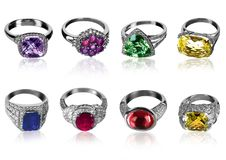 Eight rings. Eight isolated rings decorated with precious stones Royalty Free Stock Photo