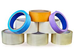 Eight rolls of sticky tape on a white background. Set of adhesive tapes for various purposes, folded in the form of a pyramid, isolated on white background with Royalty Free Stock Photos