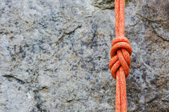 Eight rope knot on rocky background Stock Images
