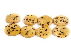 Eight round sweet chocolate chip cookie`s. A cookie is a baked or cooked food that is small, flat and sweet. It usually contains flour, sugar and some type of Stock Photo