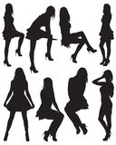 Eight silhouettes of beautiful girls. Vector illustration Stock Photos