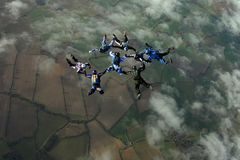 Eight skydivers building a formation. Six skydivers building a formation high up in the air Royalty Free Stock Images