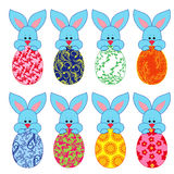 Eight small Bunnies with Easter eggs Stock Image