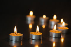Eight small candles burning Stock Image