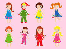 Eight small girls in various garments Stock Photography