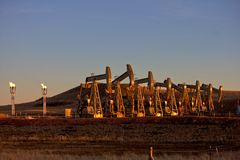 Eight Well Pad Pump Jack with Flares. Eight Oil Pump Jack with two flares in North Dakota Royalty Free Stock Photos