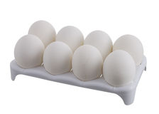 Eight white eggs with one cracked in white carton Stock Photos