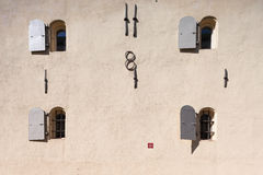 Eight windows on the wall of a medieval house Stock Image