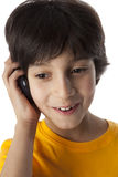 Eight year old boy with mobile phone Royalty Free Stock Photography
