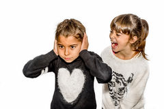 Eight year old girl being angry and shouting at her sister. Isol Stock Photo