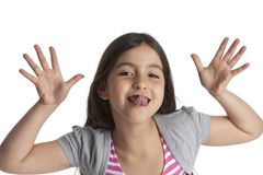 Eight year old girl making faces Royalty Free Stock Photography