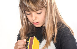 Eight year old girl playing with matches isolated on white Stock Photos
