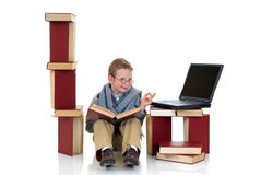 Eight year young boy studying Stock Image