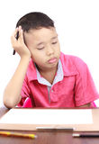 Eight years boy serious with homework Stock Images