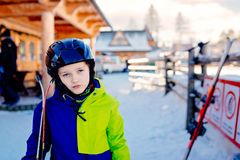 Eight years old boy in helmet on ski slope. Winter sports royalty free stock photo