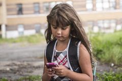 Eight years old school girl Stock Images