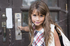 Eight years old school girl. A eight years old school girl close to the schoolyards royalty free stock image