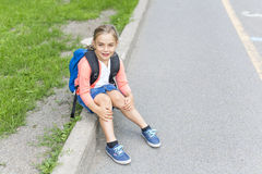 Eight years old school girl close to the schoolyards. A eight years old school girl close to the schoolyards stock image
