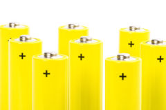 Eight yellow alkaline batteries Royalty Free Stock Photography