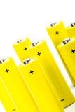 Eight yellow alkaline batteries Stock Photography