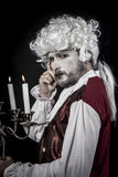 Eighteen era, gentleman rococo wig, candle Royalty Free Stock Photo
