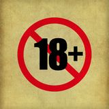 Eighteen plus Sign on beige paper texture Royalty Free Stock Photo