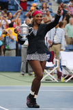 Eighteen times Grand Slam champion and US Open 2014 champion Serena Williams holding US Open trophy during trophy presentation Stock Photo