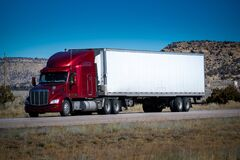 Free Eighteen Wheel Big Rig Tractor With Trailer On Highway. Trucking Industry Royalty Free Stock Photography - 196086627