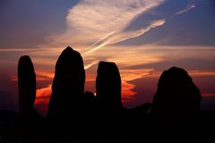 Sunset at the Summer Solstice, County Kerry, Ireland. Eightercua is thought to date from 1700 BC and is a four-stone alignment Megalithic tomb. The tallest stone royalty free stock photos