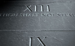 The Eighth Commandment. A 3D render of closeup of the ten commandments etched in a stone tablet highlighting the eighth Stock Images