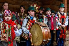 Eighth Ethnic Festival Christmas Carols in the old village. Uzhgorod, Ukraine - January 13, 2018: Children`s folklore collective performs during the eighth royalty free stock image