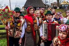 Eighth Ethnic Festival Christmas Carols in the old village. Uzhgorod, Ukraine - January 13, 2018: Children`s folklore collective performs during the eighth stock image