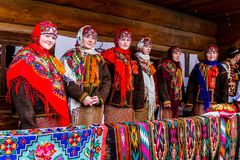 Eighth Ethnic Festival Christmas Carols in the old village. Uzhgorod, Ukraine - January 13, 2018: Female folklore collective performs during the eighth ethnic royalty free stock images