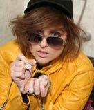 Eighties fashion metaphor woman yellow jacket Royalty Free Stock Photo