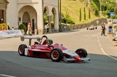 Formula 3 car at Bergamo Historic Grand Prix 2017. An eighties` Formula 3 car driving down the hairpin at the end of Boccola street in Citta` Alta the medieval Royalty Free Stock Photo