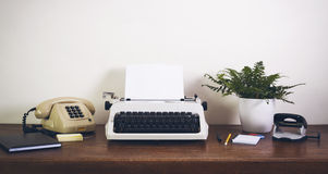 Eighties office desk. Retro / vintage office desk with different office items. Front view royalty free stock images