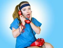 Eighties style teen girl talking on the phone Royalty Free Stock Image