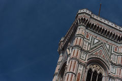 Eighty-five meter high tower Giotto`s Campanile - bell tower of the Basilica di Santa Maria Del Fiore. Eighty-five meter high tower Giotto`s Campanile designed stock photo