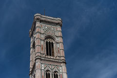 Eighty-five meter high tower Giotto`s Campanile - bell tower of the Basilica di Santa Maria Del Fiore. Eighty-five meter high tower Giotto`s Campanile designed stock images