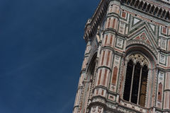 Eighty-five meter high tower Giotto`s Campanile - bell tower of the Basilica di Santa Maria Del Fiore. Eighty-five meter high tower Giotto`s Campanile designed royalty free stock image