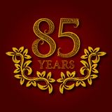 Eighty five years anniversary celebration patterned logotype. Eighty fifth anniversary vintage golden logo. With shadow Stock Photography