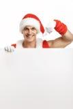 Eignung Santa Claus mit Verkäufen einer Fahne Lizenzfreies Stockbild