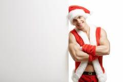 Eignung Santa Claus mit Verkäufen einer Fahne Stockfotos