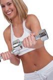 Eignungserie - blonde Frau mit Gewichten Stockfoto