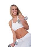 Eignungserie - Frau, die mit Gewichten trainiert Lizenzfreie Stockfotografie
