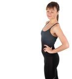 Eignungsfrau in der schwarzen Sportkleidung lokalisiert auf Weiß Lizenzfreie Stockfotos